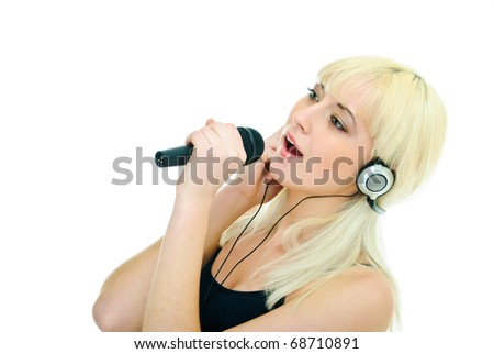 pretty girl  sings to microphone in headphones