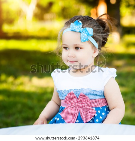 Pretty girl sits in a green park and feels the world inside and outside herselfe of what feels happy