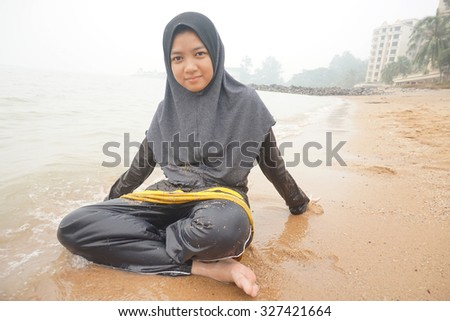 pretty girl sitting on a beach