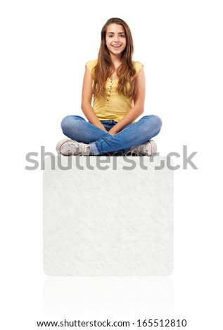 pretty girl sitting on a big white box isolated on white - stock photo