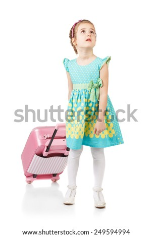 Pretty girl sitting on a suitcase, isolated on white background - stock photo