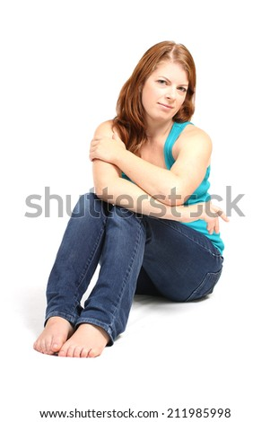pretty girl sitting on a white background