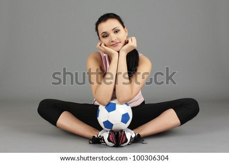 pretty girl sitting on the floor with a Ball - stock photo