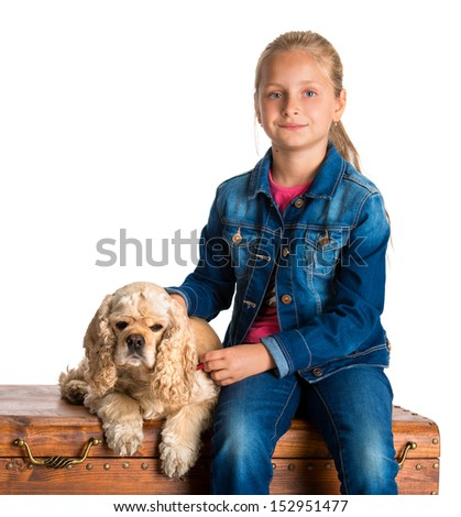 Pretty girl sitting with american spaniel on a wooden chest on a white background