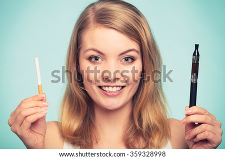 Pretty girl smoking normal and electronic cigarette. Addicted nicotine problems in young age. Addiction concept. - stock photo