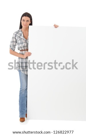 Pretty girl standing with a huge blank sheet.