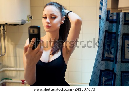 Pretty girl take a self portrait with her smart phone  - stock photo