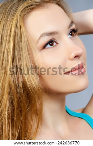Pretty girl teenager with long hair and beautiful smile expressing happiness. Hair care, healthy hair.  - stock photo