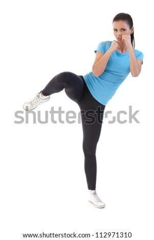 Pretty girl training, kick-boxing. - stock photo