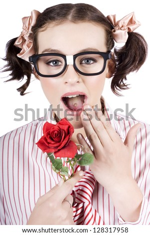 Pretty Girl Wearing Dorky Eye Glasses Expressing Shock While Holding A Red Rose Flower In A Valentines Day Concept, Isolated Over White Background - stock photo