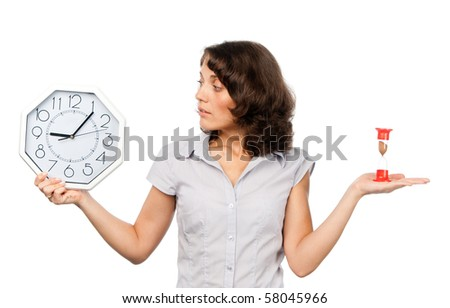 Pretty girl with a clock and hourglass