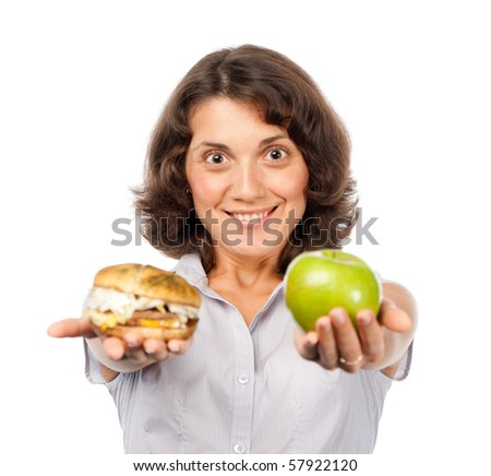 Pretty girl with a green apple and hamburger