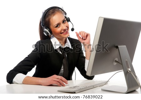pretty girl with a headset works at the computer