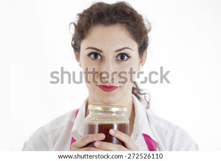 pretty girl with a jar of honey in her hands