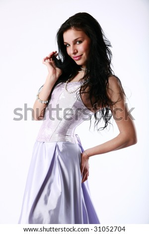 Pretty girl with a lilac dress - stock photo