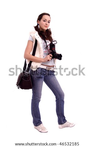 Pretty girl with a modern slr camera and shoulder bag isolated over white background
