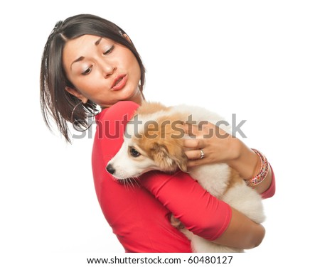 Pretty girl with a puppy - stock photo