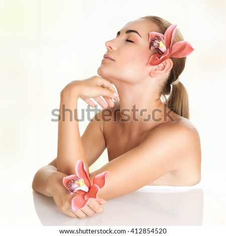 Pretty girl with closed eyes enjoying day spa, body care, healthy lifestyle, beauty treatment in a spa salon, relaxation during medical beauty treatments - stock photo