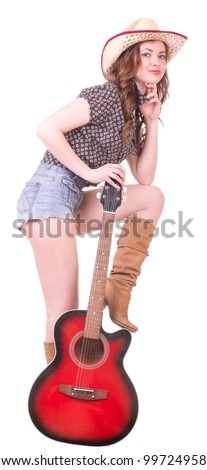 Pretty girl with cowboy hat with guitar on white background - stock photo
