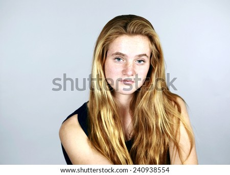 pretty girl with freckles and long red-blonde hair - stock photo