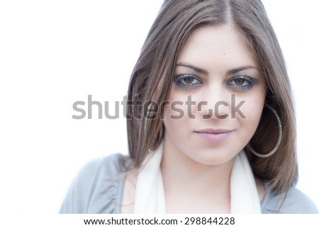 Pretty girl with gloves ,scarf and hoop earrings - stock photo