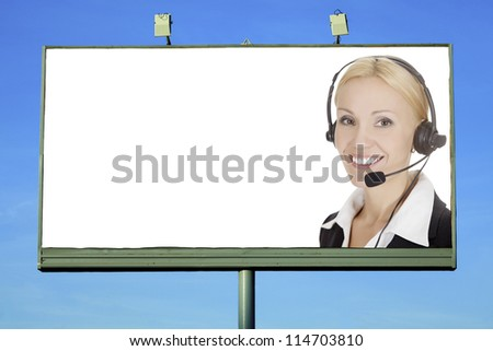 Pretty girl with headset smiling to you from street billboard with a space for your text