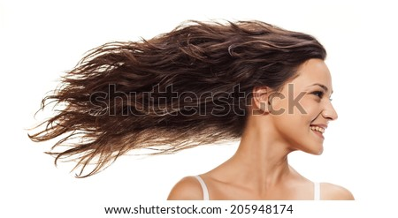Pretty girl with long blowing wavy hair - stock photo
