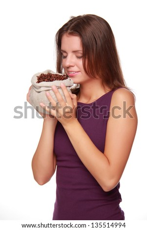 Pretty girl with long dark hair  holding a bag of coffee beans on a white background on Food and Drink