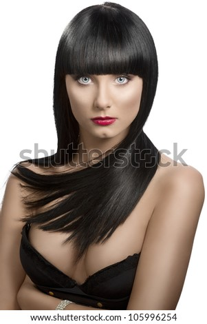 pretty girl with long, dark smooth hair and fringe, she is in front of the camera wiuth crossed arms and looks in to the lens