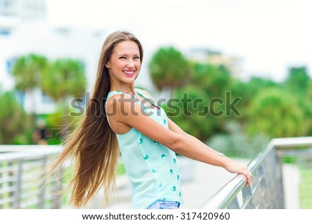 pretty girl with long hair and amazing smile - stock photo