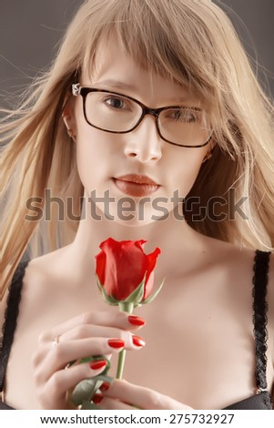 pretty girl with long hair and red rose in black