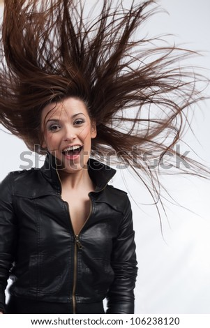 Pretty girl with long hair on a white background