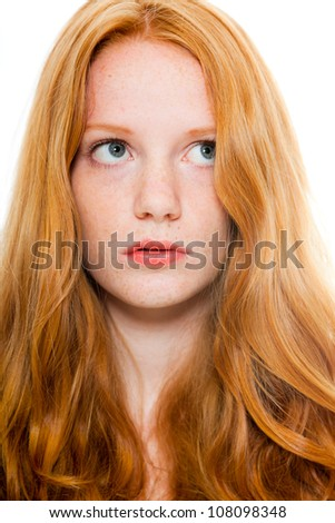 Pretty girl with long red hair wearing brown shirt. Fashion studio shot isolated on white background.