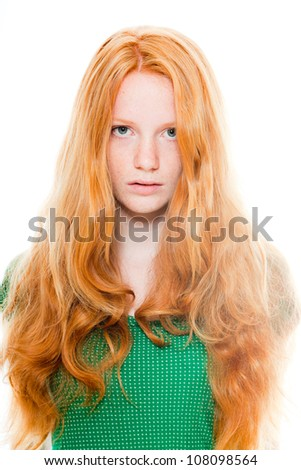 Pretty girl with long red hair wearing green shirt. Natural beauty. Fashion studio shot isolated on white background. - stock photo
