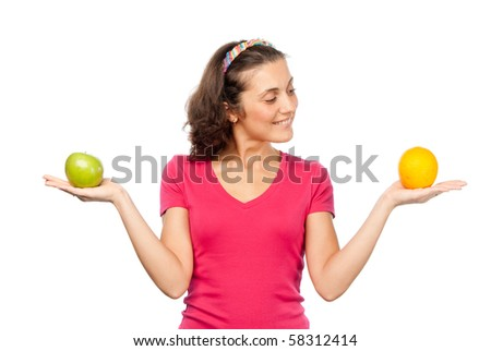 Pretty girl with orange and green apple - stock photo