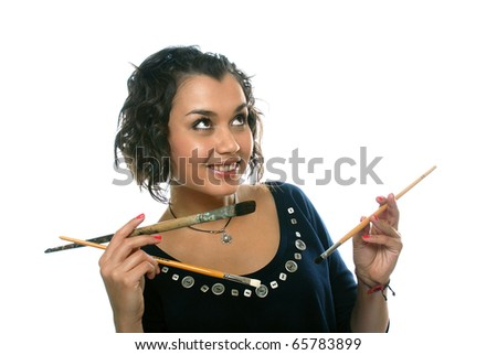 pretty girl with paint brushes - stock photo