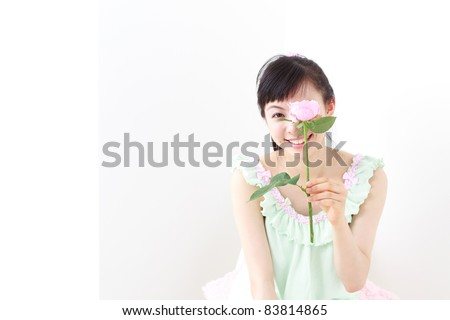 pretty girl with pink rose - stock photo