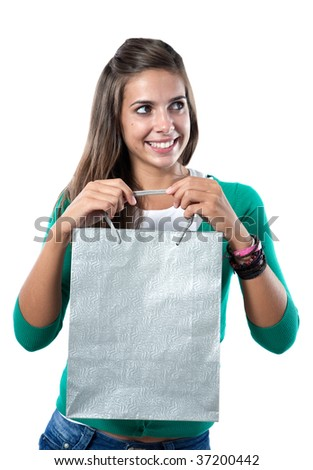 Pretty girl with silvered bag shopping on a over white background