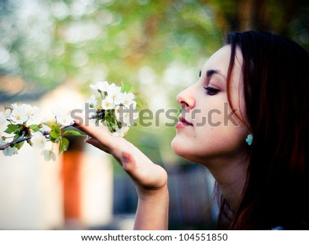 Pretty girl with spring flowers