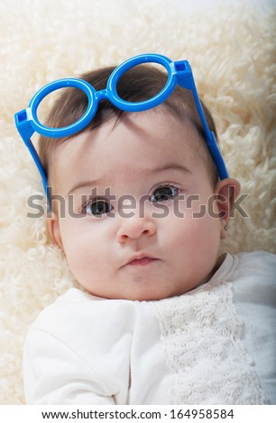 Pretty girl with sunglasses on her head - stock photo