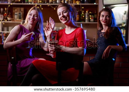 Pretty girls having an evening meeting in the club