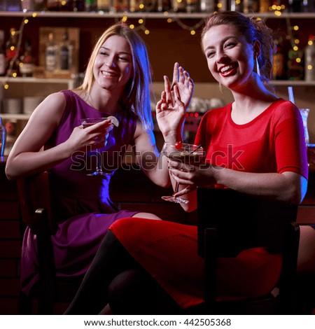 Pretty girls having an evening meeting in the club - stock photo