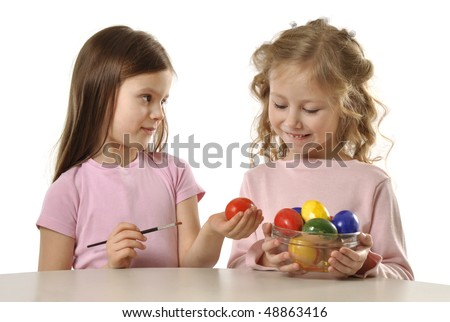 pretty girls painting Easter eggs