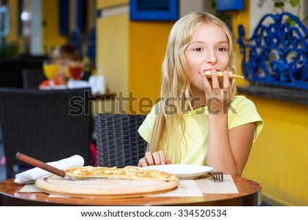 Pretty girls smiling when drinking juice and eating pizza - stock photo