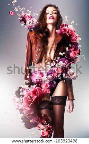 pretty gorgeous erotic woman in brown jacket with flowers - stock photo