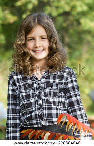 Pretty haired little girl outdoor portrait - stock photo
