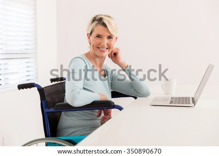 pretty handicapped mid age woman relaxing at home - stock photo