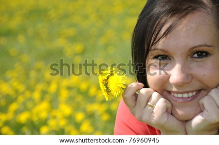 Pretty happy women with dandelions
