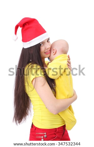 pretty happy young mother with the cute little baby dressed in new year cap - stock photo