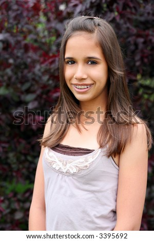 pretty hawaiian preteen with braces smiling - stock photo